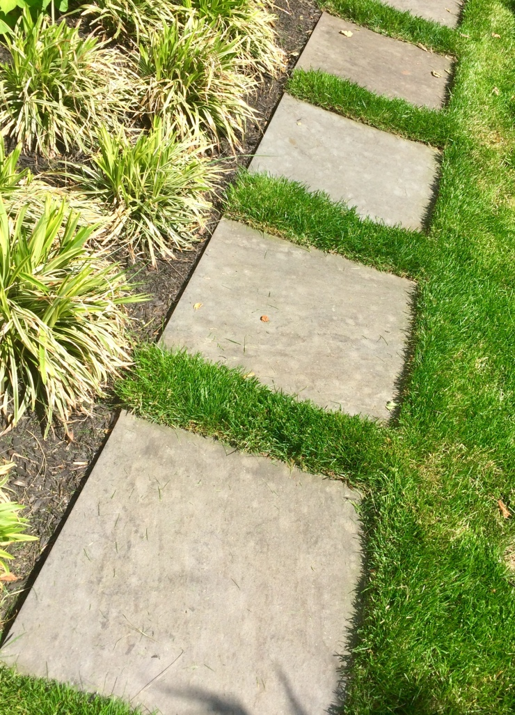 flagstone path through lawn