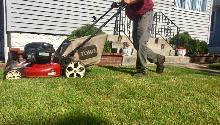 push mowing front lawn